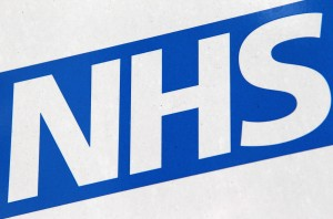 LONDON, ENGLAND - OCTOBER 13: The NHS logo on a sign outside St Thomas' Hospital on October 13, 2011 in London, England. Inspections carried out by the Care Quality Commission in England have found concerns in the standard of basic elderly care in over half the hospitals assessed. (Photo by Oli Scarff/Getty Images)